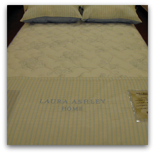 Blue Laura Ashley mattress at Sleepys.